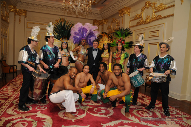 Dancers for NYC event in exotic outfits and musical instruments