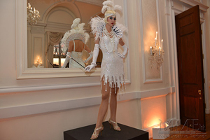 Great Gatsby themed performer at sweet 16 in white dress